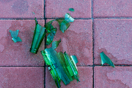 prick: Dangerous shards of glass. Broken bottle on the sidewalk. Stock Photo