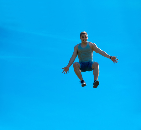 Jumping up guy. Background blue sky. Free fall Stock Photo