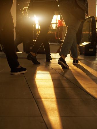 People shopping in department store. Defocused blur background.