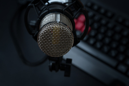 Professional condenser studio microphone over the keyboard. Stock Photo