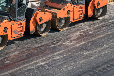 construction vibroroller: Several heavy vibration rollers at asphalt pavement works. Road repairing.