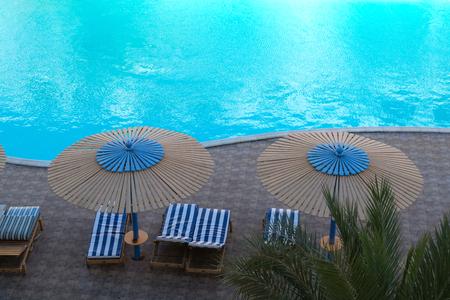 Top view of luxury swimming pool. Exterior design.