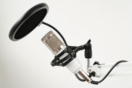 Professional condenser studio microphone on the white background. Stock Photo