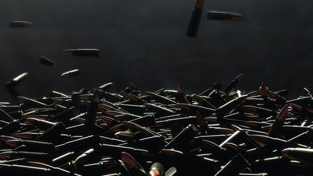 Many bullets fall on the table. In the background a dark wall.