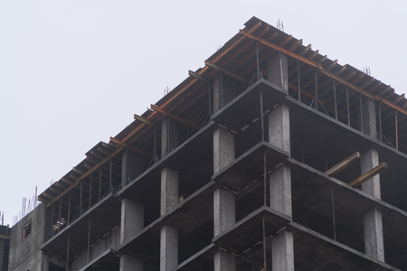 Construction of houses in winter. Severe weather.