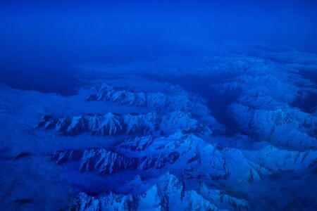 Mountains view from the airplane in the night
