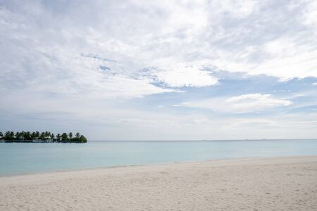 Wide sandy beach on a tropical island in Maldives. Indian ocean