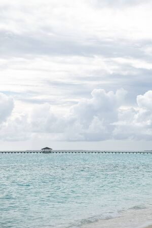 Bridge between the islands in the Maldives. Wide sandy beach on a tropical island in Maldives. Indian ocean