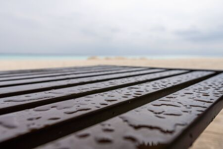 Wooden chair on the beach after a rain