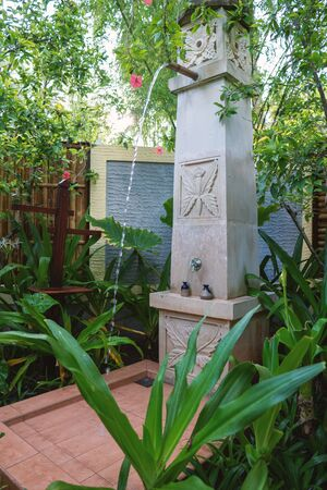 Exotic column shower in the open air spa