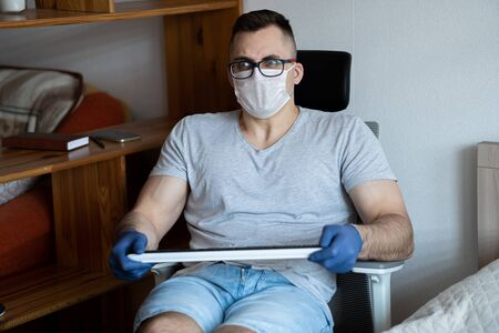 The quarantined guy works remotely from home. Communication, people and freelance work concept