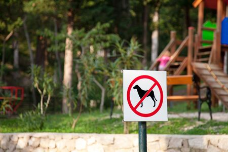 Prohibition sign no dogs in children playground. Animals not allowed in park.