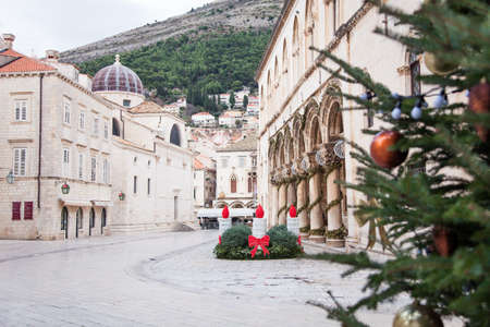 Christmas tree and street decoration in old town of Dubrovnik, Croatia. Amazing ancient architecture, cathedral, square. Authentic festive atmosphere.