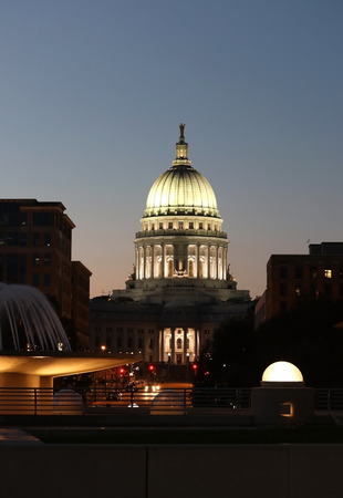 Wisconsin State Capitol building, National Historic Landmark. Madison, Wisconsin, USA. After sunset  scene, view from Monona terrace balcony, vertical composition.