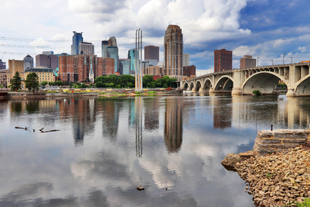 Minneapolis downtown skyline and Third Avenue Bridge above Mississippi river. Midwest USA, Minnesota state.