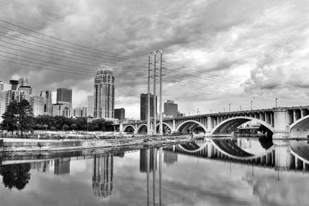 Minneapolis downtown skyline and Third Avenue Bridge above Mississippi river in black and white. Midwest USA, state of  Minnesota. Stock Photo