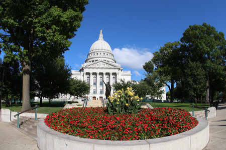 Wisconsin State Capitol building with the flower bed on foreground, National Historic Landmark. Madison, Wisconsin, USA. Horizontal composition, fish eye lens.