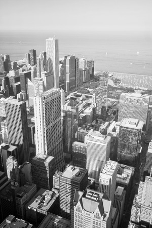 Chicago skyline and lake Michigan. An overhead view of the great city of Chicago downtown taken from the Willis (Sears) Tower. Vertical composition in black and white.