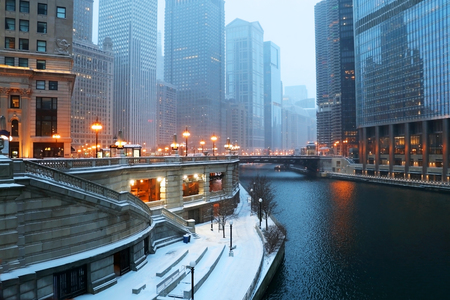 Beautiful Chicago downtown cityscape twilight winter view during snowfall. Illinois, Midwest USA.
