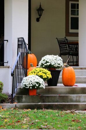 Main entrance stair and porch of the stylish house decorated for autumn holidays season. Halloween concept. Fall background.