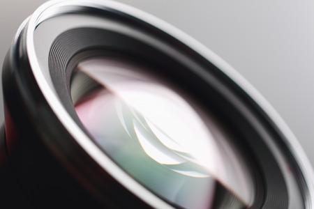 Camera lens close-up on gray background photo