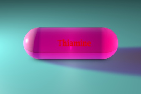 Transparent pink thiamine capsule. Vitamin and mineral complex. Medical background. 3d illustration Stock Photo