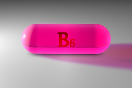 Transparent pink vitamin B6 capsule. Vitamin and mineral complex. Medical background. 3d illustration Stock Photo