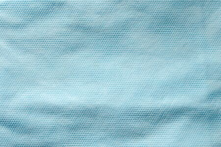 Texture of blue non-woven fabric for sewing disposable protective medical clothing
