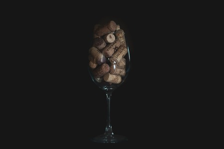 wine corks in the wine glass. isolated background