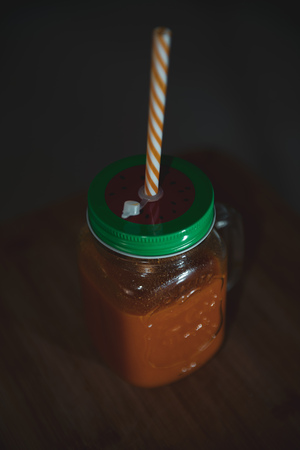 Fresh juicy in mason jar with a color straw Stock fotó
