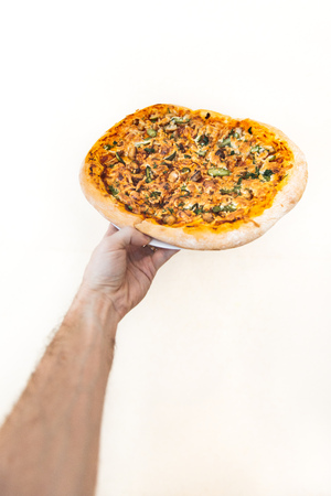hand hold pizza isolate on white background