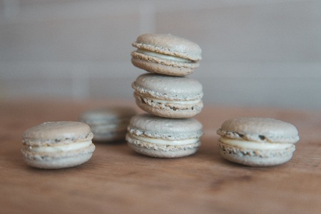 Cake macaron or macaroon on grey background, sweet and colorful dessert