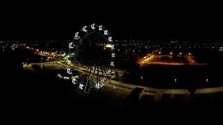 Ferris wheel in a night park. Volzhsky city. Russia
