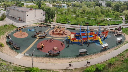 Children playground on yard activities in public park. Aerial view Stock fotó