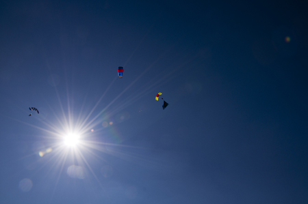Paraglider flies paraglider in the sky. Paragliding.