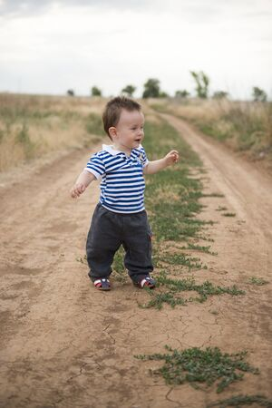 Babys first steps in nature. The first independent steps.