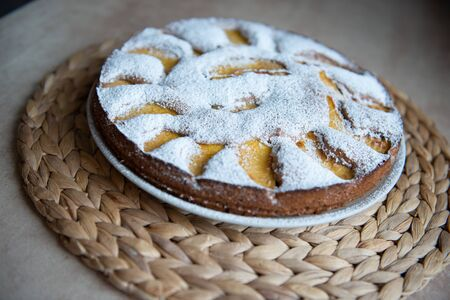 Russian charlotte with peach and icing sugar. Ornament of peach slices Stock fotó