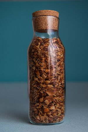 Muesli in a glass jar. Kitchen food storage system Stock fotó