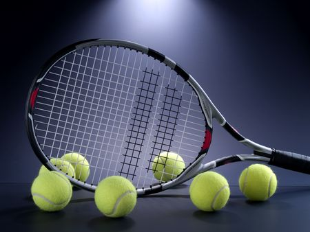 tennis racket: tennis racket and seven balls on black