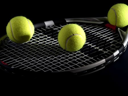 tennis racket: tennis racket with three balls