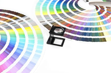 Two Color charts and a magnifying glass. Cold colors The image is processed from 16 bit RAW files in RGB and is professionally retouched to achieve the best possible image quality. Stock Photo - 6953872
