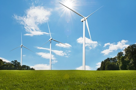 Three wind turbines on a green meadow  generating electricity photo