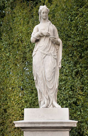 statuary garden: The Statue of Hygenia on the Great Parterre, Schonbrunn Palace Stock Photo