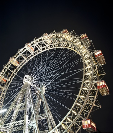 Wiener Riesenrad in Prater - oldest and biggest ferris wheel in Austria. Symbol of Vienna city at night photo