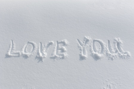 LOVE YOU written on the fresh snow