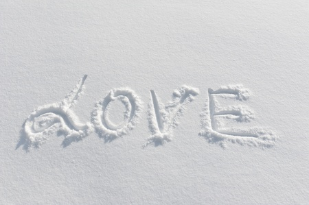 The word LOVE written on the snow photo