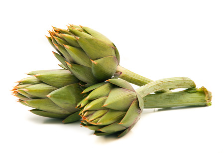 fresh artichokes on white background
