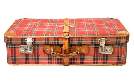 Vieille valise vintage sur un fond blanc