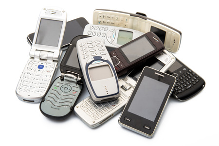 broken telephone: old and obsolete cellphones on white background Stock Photo