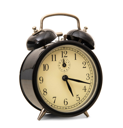 an old alarm clocks on white background photo